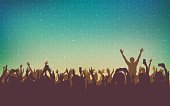 silhouette of people raise hand up in concert with smart phone and digital dot pattern on vintage color background