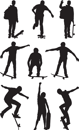 Silhouette of people skateboarding