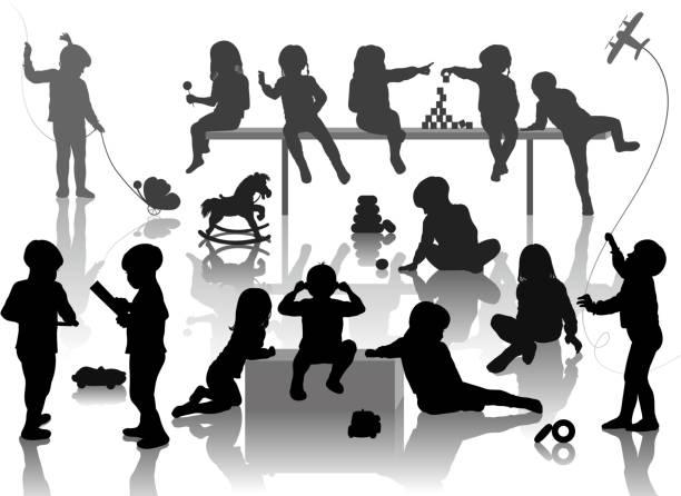 silhouette of playing children vector art illustration