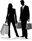 A vector silhouette illustration of a fashionable young man and woman carrying chopping bags.