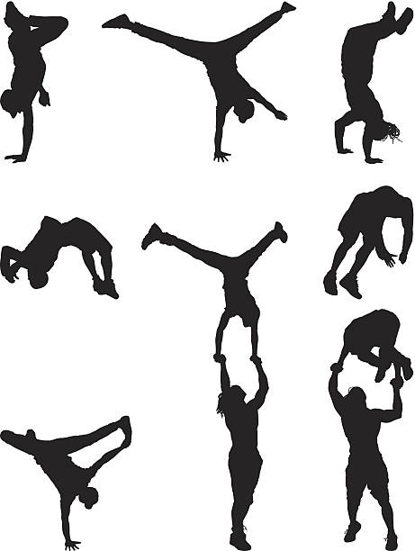 Silhouettes break dancing and flipping vector art illustration