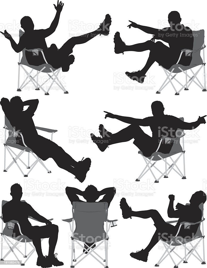 Silhouettes of a man sitting in chair vector art illustration
