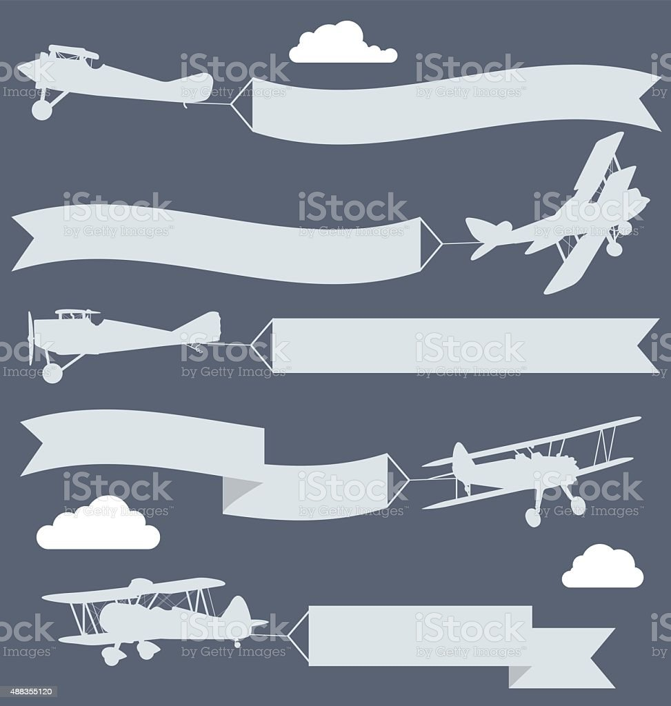 Silhouettes of biplanes with wavy greetings banner vector art illustration