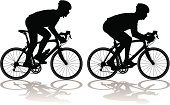 Vector illustration of two carbon fiber racing bicycles with cyclists, one in drops and one standing and sprinting.