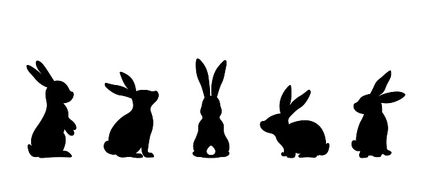 Silhouettes of easter bunnies isolated on a white background. Set of different rabbits silhouettes for design use.