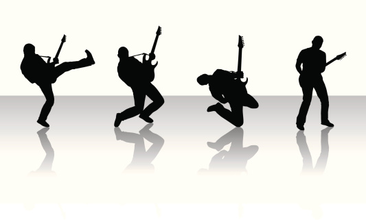 Silhouettes of guitarists