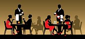 Silhouettes of people sitting at tables in a restaurant