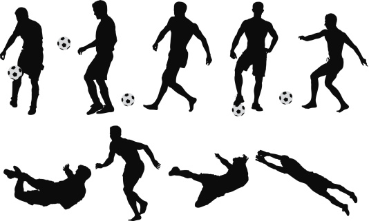 Silhouettes of soccer player