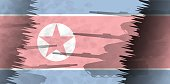 Silhouettes of tanks against the background of the flag of North Korea. Military background. Conflict in Asia.