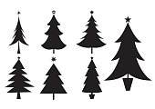 Various different styles of Christmas trees in silhouette.