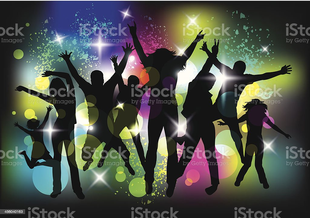 Silhouettes of young people dancing at a party