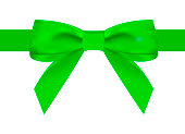 Silk green ribbon with a beautiful knot on a white background. Can be used for the design of gifts, postcards, congratulations.