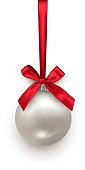Silver Christmas ball with red bow and ribbon isolated on white background. Vector Christmas and New Year design element