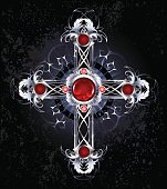 silver cross of interwoven leaves, decorated with round rubies on a black background