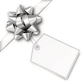 Silver Gift Bow with Ribbon and Tag. Vector illustration. EPS10 drop shadow effect.