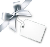 Silver gift bow with tag. EPS10 drop shadow effect.