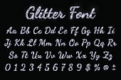 Silver glitter font on black background. Vector