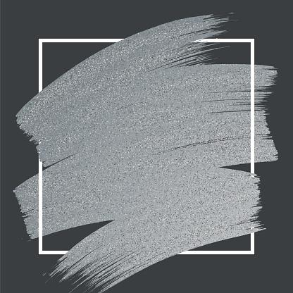 Silver Glitter Paint Brush Stroke with Frame on Black Background.