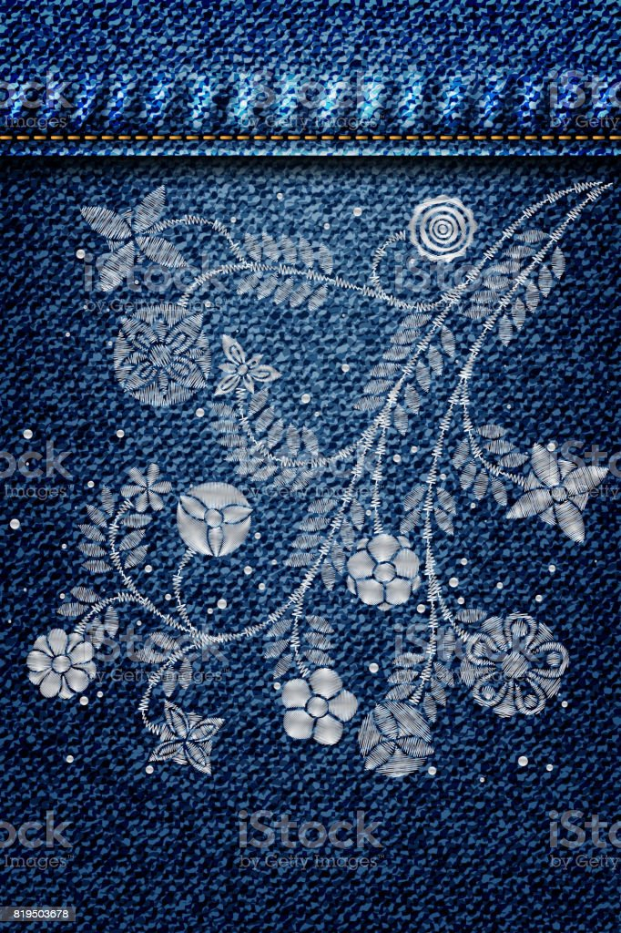 silver lace flower embroidery on jeans or blue denim background