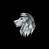 Silver metallic lion head. Polygon style lion emblem on a black background.