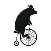 Simple bear on bike icon