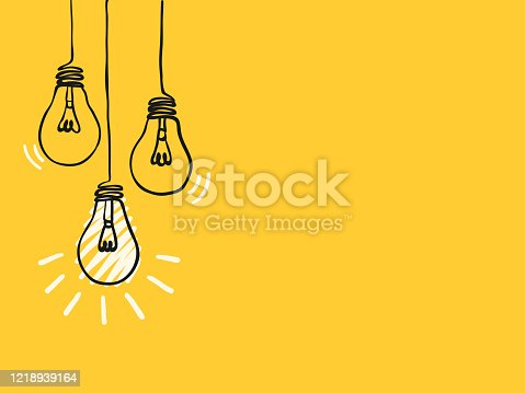 istock simple black childish hand drawing lines lightbulbs on yellow for background, texture, wallpaper, banner, label etc. with copy space. vector design. 1218939164