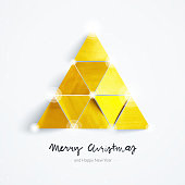 Square Christmas Card with abstract Christmas Tree arranged with nine small hand crafted and hand painted on gold color triangles. Composition isolated on light gray paper background with beautiful soft light and realistic soft shadows. Handwritten text under: Merry Christmas and Happy New Year.  Simple elegance luxury card design.  Zoom to see the details. VECTOR ILLUSTRATION - enlarge and wait without lost the quality!