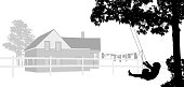 Silhouette illustration of a child using a swing in his large yard by a little house