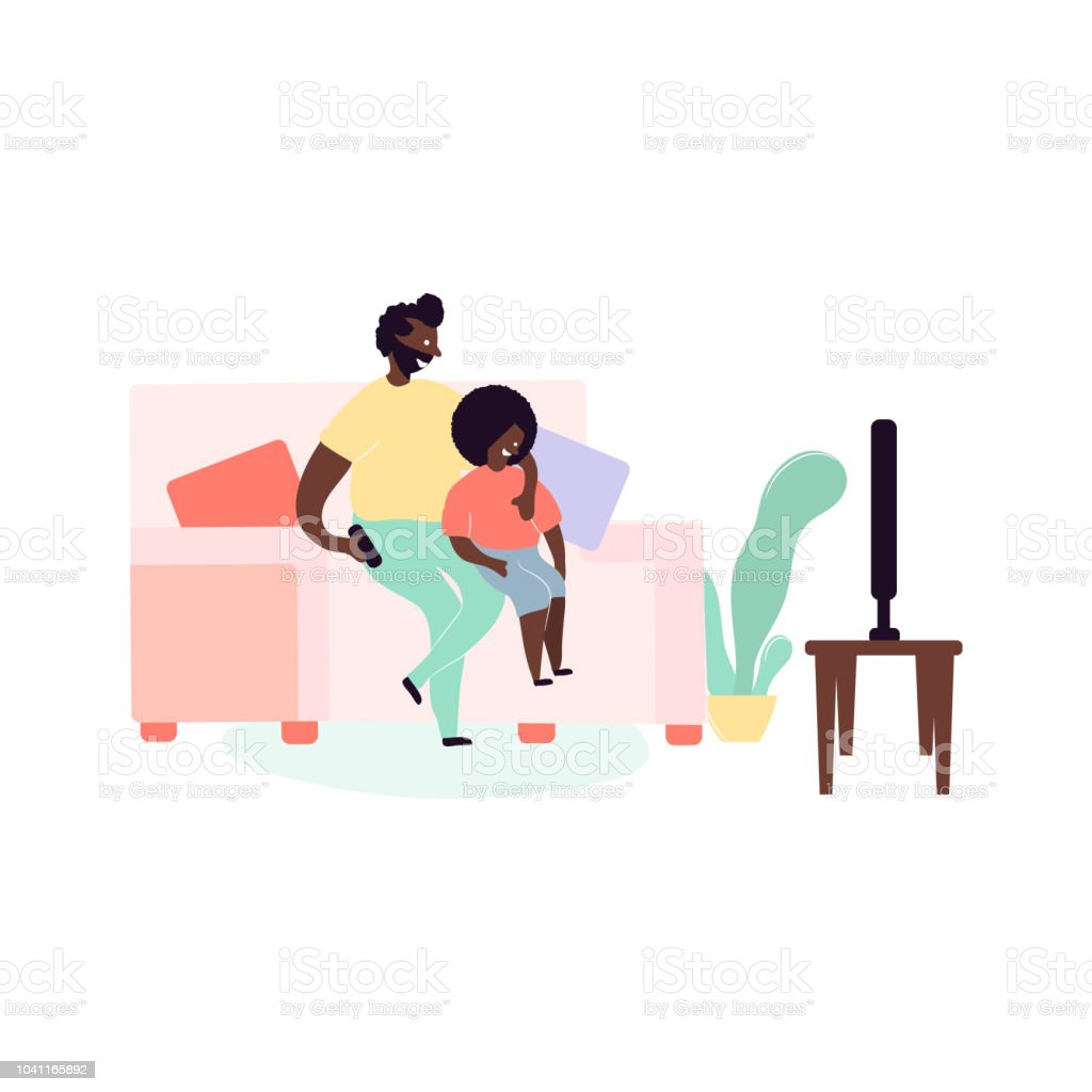 Single black father and son african americans sitting on sofa watching TV  royalty-free single