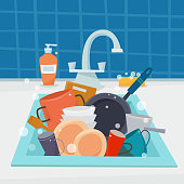 Sink with clean kitchenware and dishes, utencil and sponge.