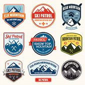 Set of ski patrol mountain badges and patches.