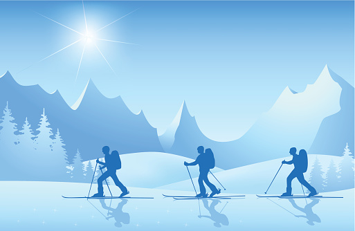 Skiers on tour in the mountains at sunshine