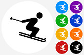 Skiing Icon on Flat Color Circle Buttons. This 100% royalty free vector illustration features the main icon pictured in black inside a white circle. The alternative color options in blue, green, yellow, red, purple, indigo, orange and black are on the right of the icon and are arranged in two vertical columns.