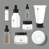 A variety of skincare products, including bottles and creams, for a common beauty regimen