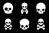 Skull and crossbones icons in cartoon style
