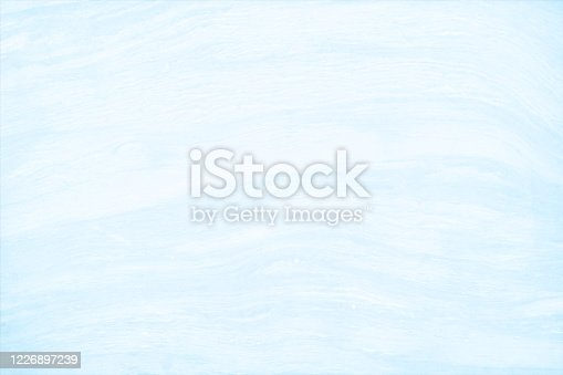 Horizontal vector illustration of a marble effect pale blue and white colored smudged, empty, blank, wall texture vector background.