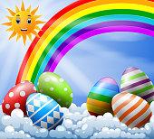illustration of sky with Easter eggs near the rainbow