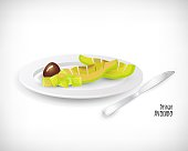 Slice of avocado, avocado pieces, seed on white plate. Silver knife near the plate. Lunch, dinner, breakfast, snack. Lettering Avocado Design.