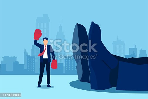 Vector of a small businessman with boxing gloves and arms raised in victory standing near a giant rival fallen down.
