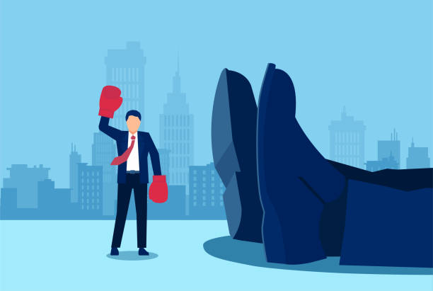 small businessman with boxing gloves and arms raised in victory standing near a giant rival fallen down. - маленький stock illustrations