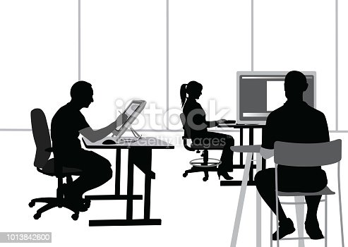Digital artists and programmer working in an open office