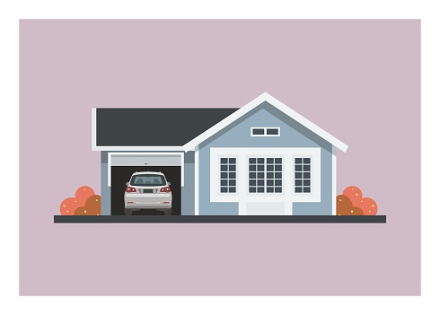 Small home with a car in its opened garage.