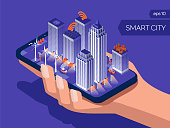 Smart city connection and control.  Eco friendly night town. IOT concept. Internet of things isometric style. Smart phone in human hand on blue background