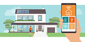 Smart home app with control system, eco house on the background and family posing, technology and lifestyle concept