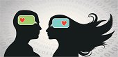 """Couple thinking """"I Love You"""" with smartphone type messages."""