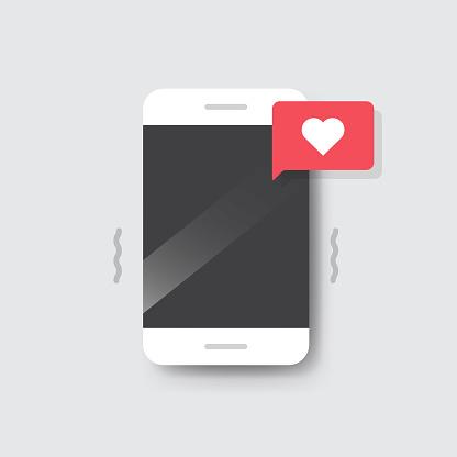 Smartphone with Heart Emoji Speech Bubble Message on Screen.