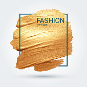 Smear with an artistic brush. Gold grunge texture. Vector image.