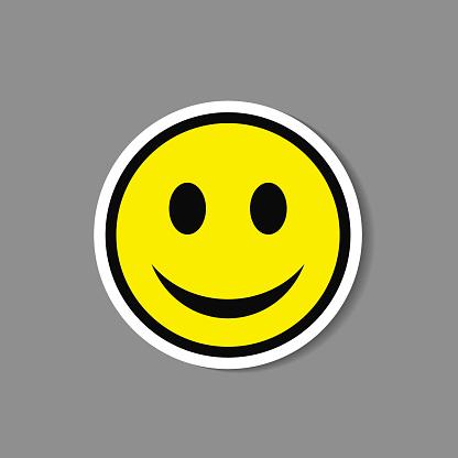 Smiley paper sticker. Vector happy face emoticon label. clipart