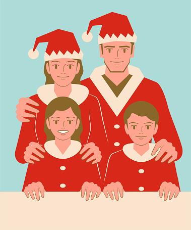 Smiling beautiful young family with two children dressed in a Santa Claus suit holding a blank sign