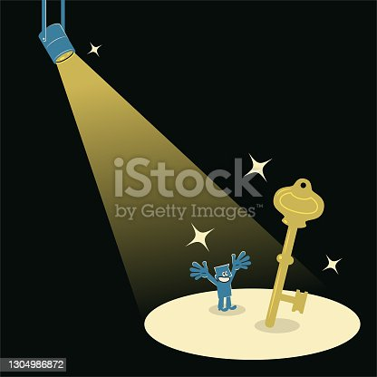 istock Smiling businessman finding a big gold key in the spotlight 1304986872